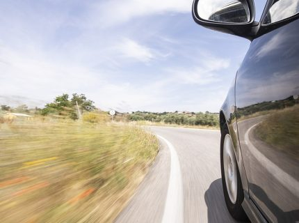 Reduce over cornering with driver behaviour